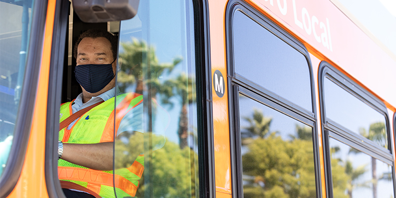 Bus operator driving a bus